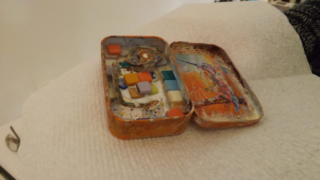 A creation piece representing a safe space using Altoid tins.