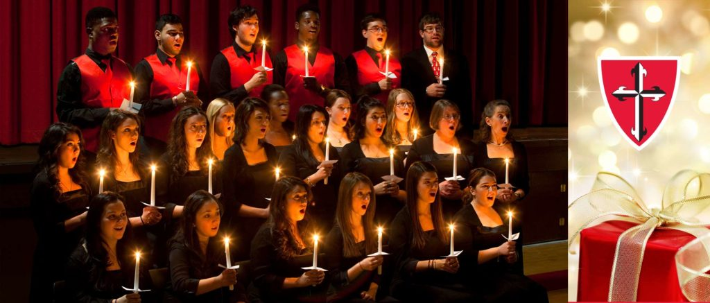Group of Caldwell University singing Choirs with candles on their hands.