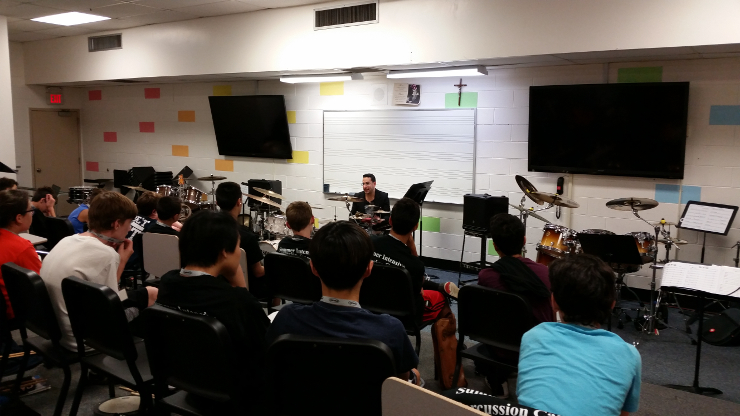 Broadway musician Andres Forero addressing precussion camp