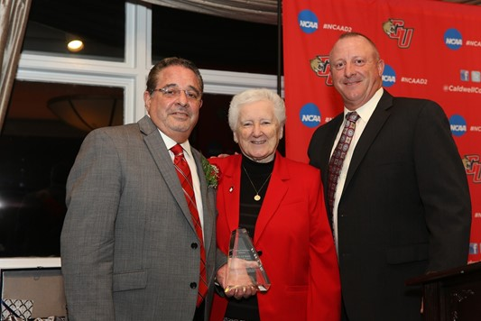 (left to right): Inductee Mark A. Corino, Sister Michele Rodgers, Dean Johnson