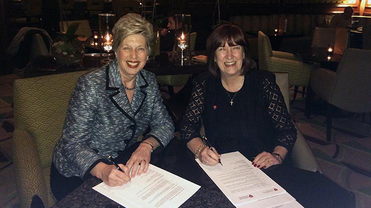 Caldwell University President Nancy Blattner and Leeds Trinity University Vice Chancellor Margaret A. House signing a memorandum of understanding for an exchange program.