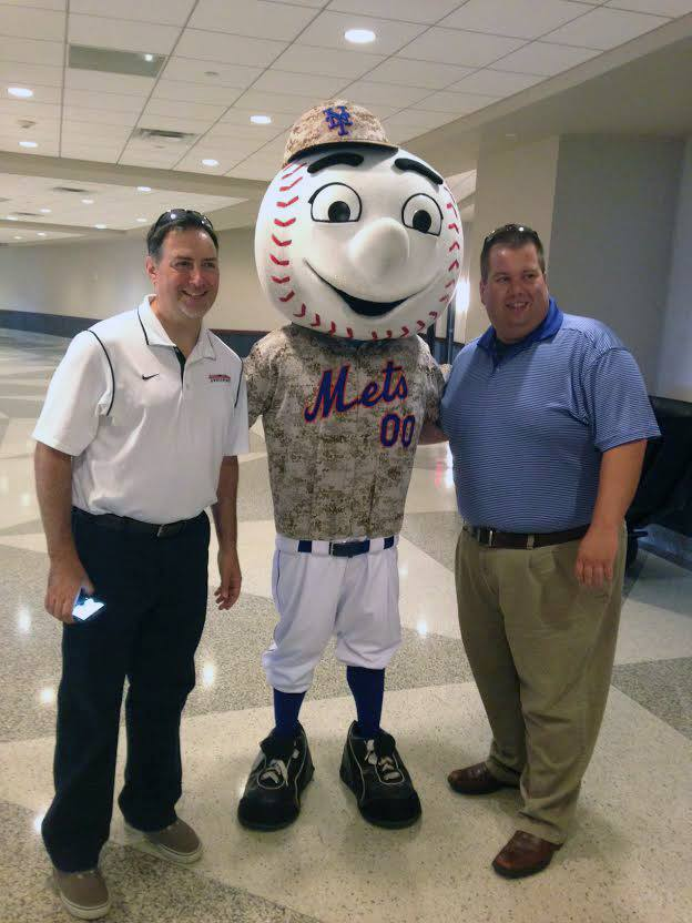 Vice President of Enrollment Management and Communications Joseph Posillico and Assistant Vice President of Enrollment Management Steve Quinn sealing the deal with Mr. Met.