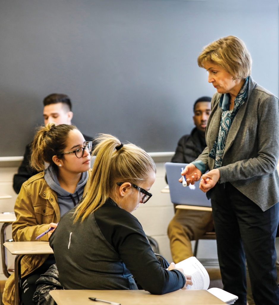 Professor Virginia Rich with students