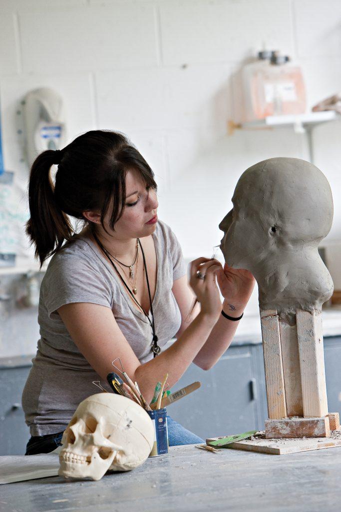 student sculpting in art class