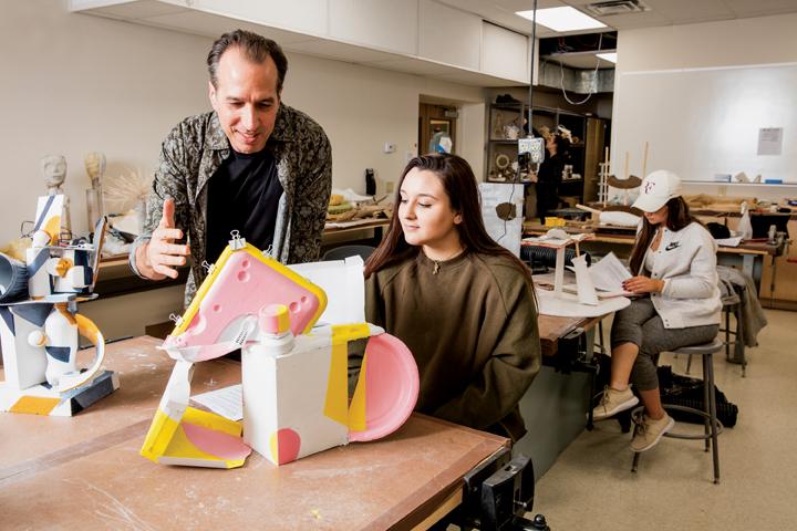 Professor Kendall Baker with art student