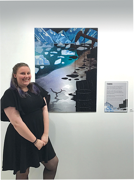 Art student with work in gallery
