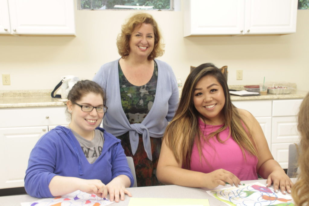 Dr. Vaccaro and students in the art therapy center