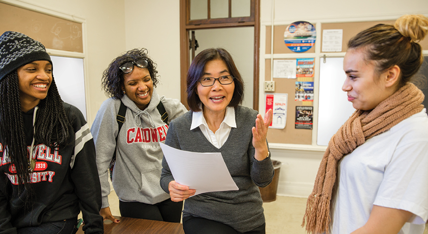 Sociology Professor Dr. Yang Cai with students