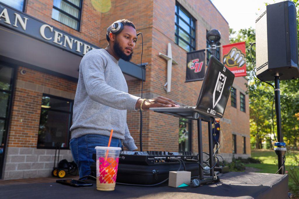 student DJing at Club Fair