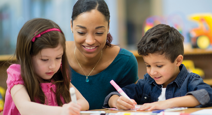 Student teacher teaching kindergarten children