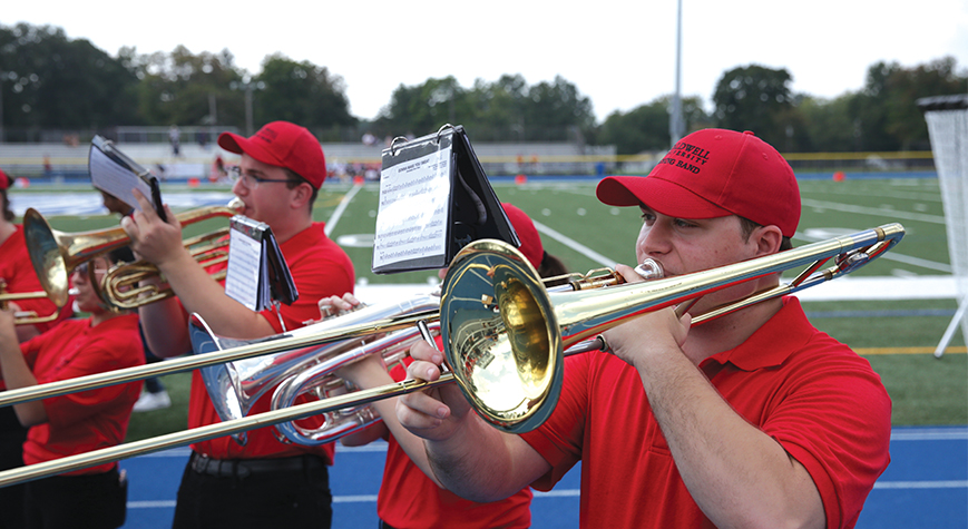 Marching band performing during a game