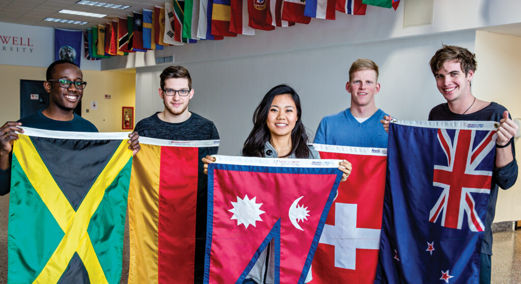 5 international students holding flags
